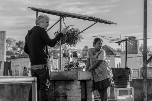"Alfonso Cuarón and Yalitza Aparicio on the set of ""Roma"""